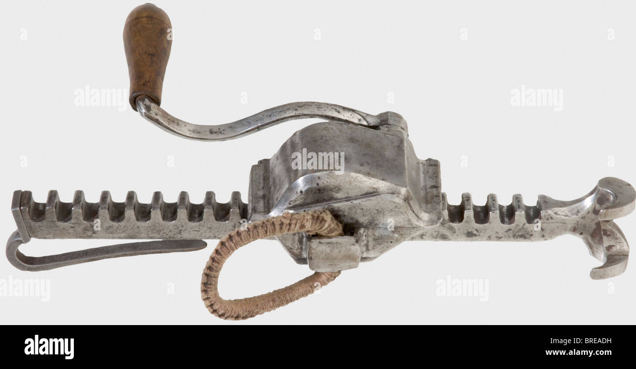 A German crossbow cranequin, 1st half of the 16th century Gearbox of forged iron with bevelled edges and brass inlaid - Stock Image