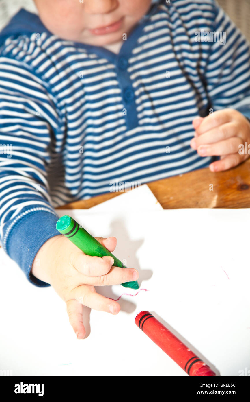 child coloring with crayons Stock Photo: 31663560 - Alamy