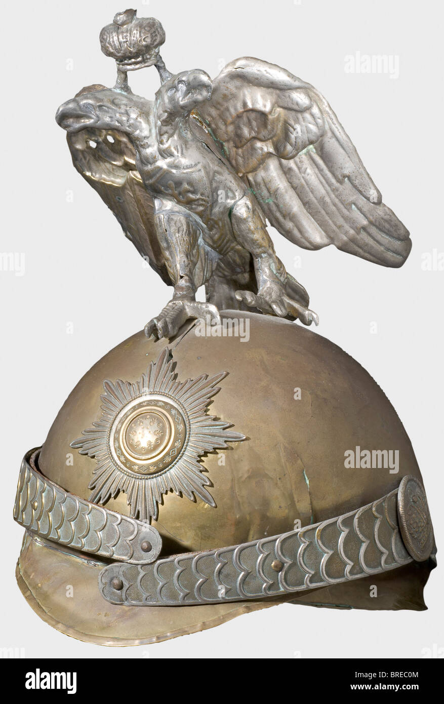 A child's helmet, Horse Guards A toy helmet for children of the pattern used by the Cuirassier Guards. Brass. - Stock Image