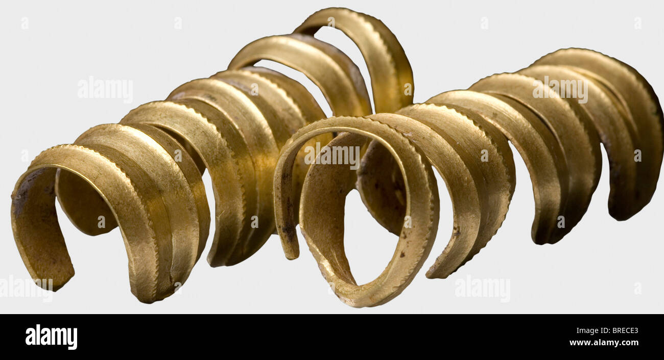 A pair of Central European golden temple rings, Urn Field period, circa 1200 B.C. Finely worked sleeves of flat - Stock Image