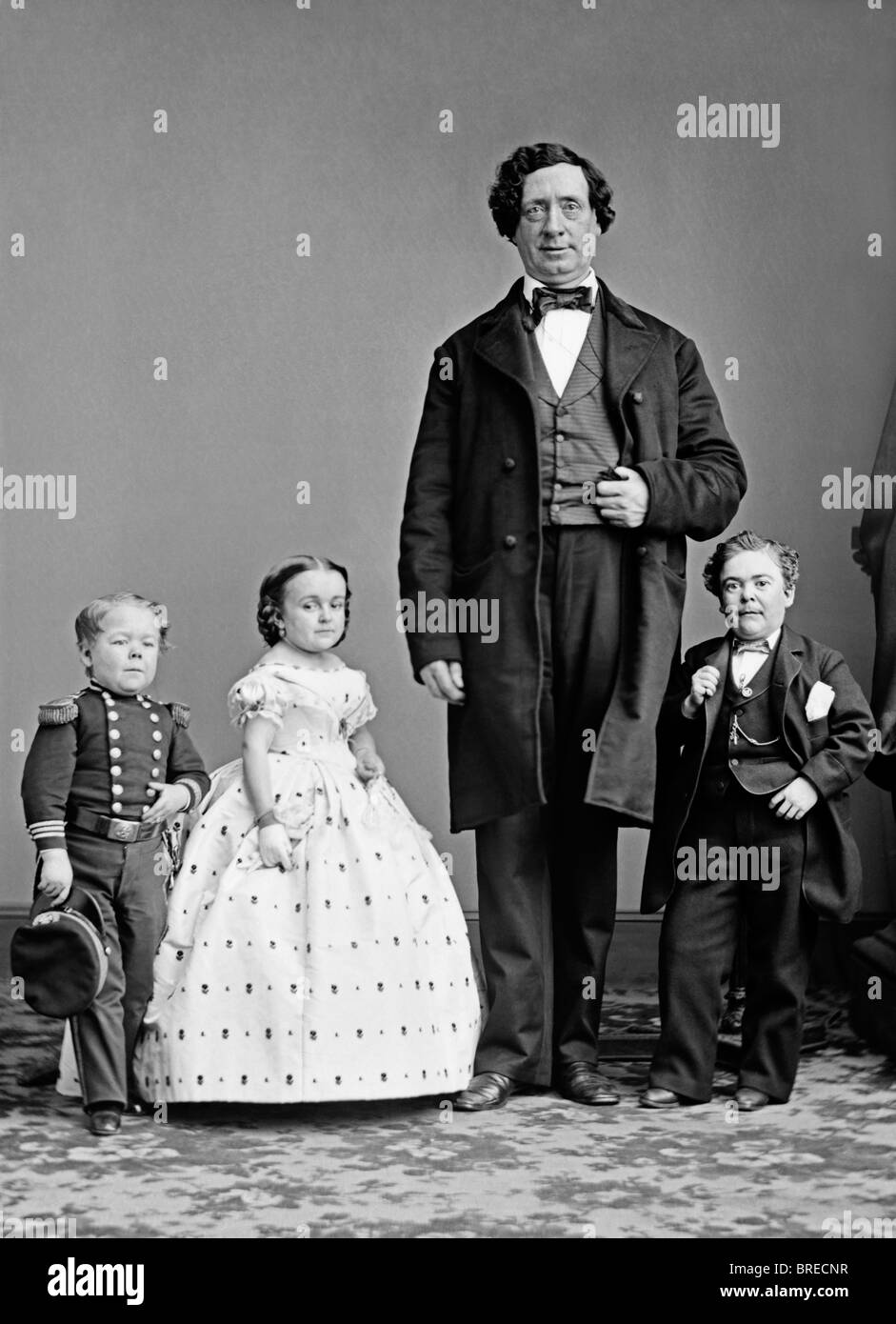 Famous stars of P T Barnum's 19th century shows - Commodore Nutt, Lavinia Warren, unidentified 'giant' - Stock Image