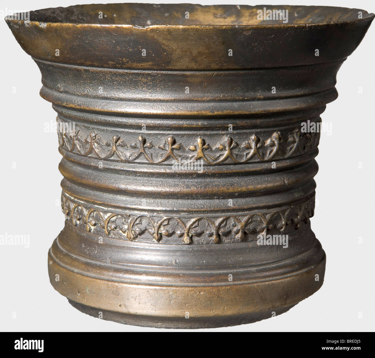 A Dutch bronze mortar, 16th century Bronze with darkened age patina. Cylindrical body with widely flared lip and - Stock Image