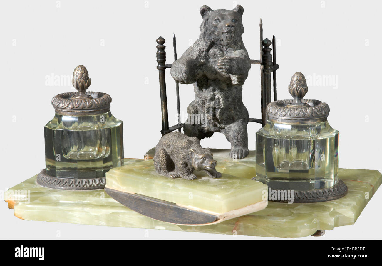 An eight-piece 'bear' desk set, circa 1900 Bronze, green marble, and crystal glass. Consisting of an inkwell - Stock Image