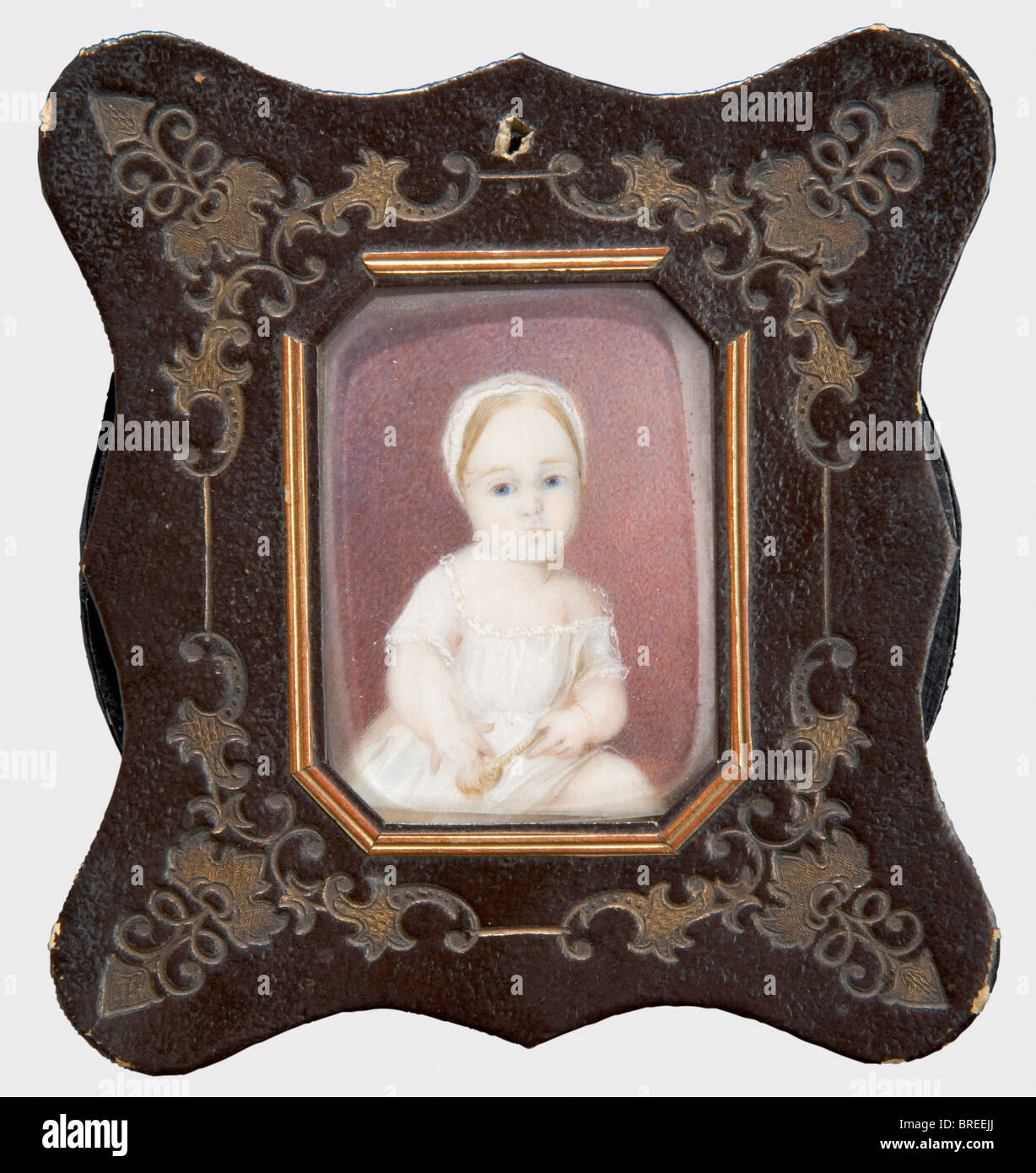 A miniature portrait of a young girl, no signature, ca. 1860 Watercolour on ivory. The girl wearing a white dress - Stock Image