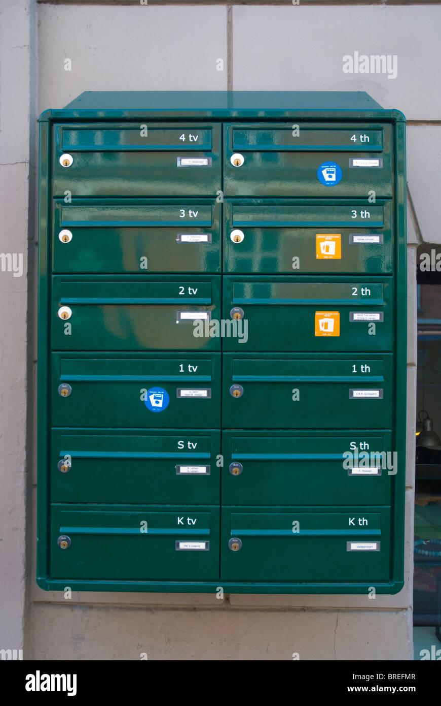 Postboxes outside a residential building Norrebro district central Copenhagen Denmark Europe - Stock Image