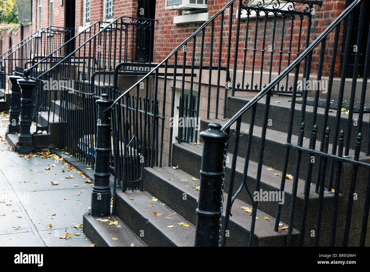 Superior Stairs At Home Entrances Typical To Manhattan, New York. Autumn Leaves At  The Stairs That Lead To Brick Houses