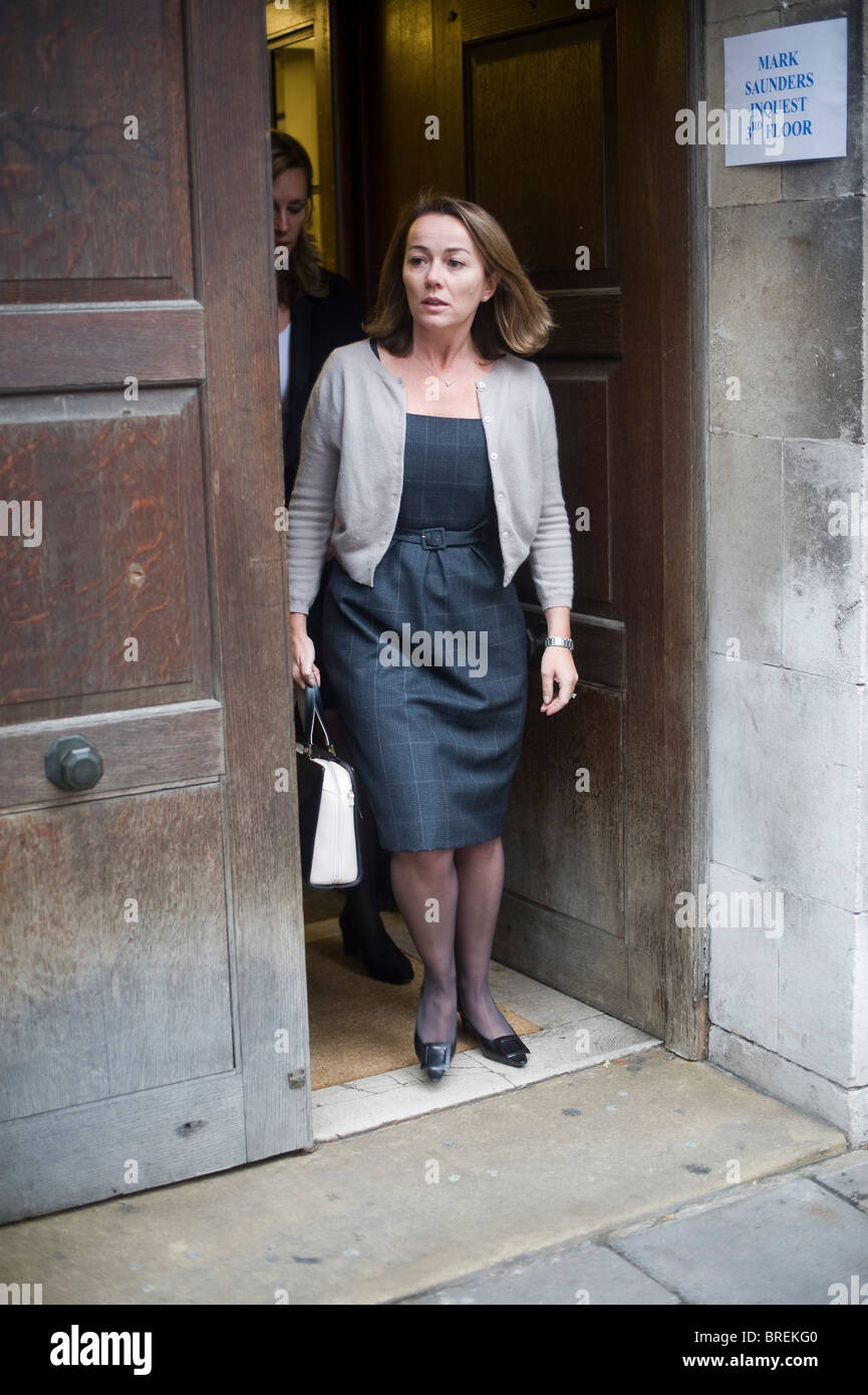 Elizabeth Clarke Saunders widow of Mark Saunders barrister shot dead police in Markham Square London leaves inquest - Stock Image