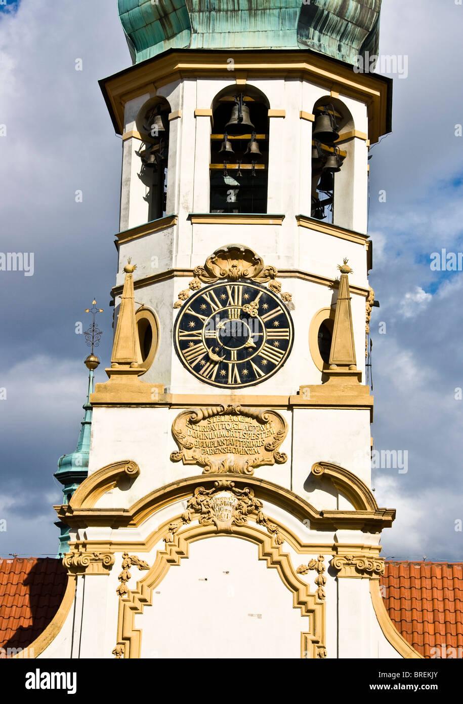 Baroque clock tower of Loreta Church Prague Czech Republic Europe Stock Photo