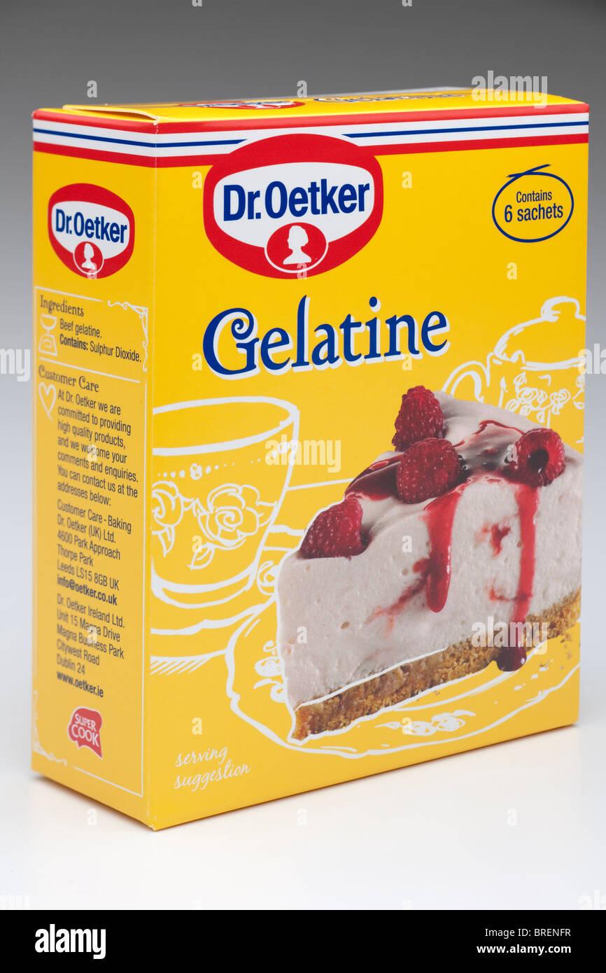 Yellow cardboard box of Dr.Oetker Six Sachets of gelatin Gelatine. - Stock Image