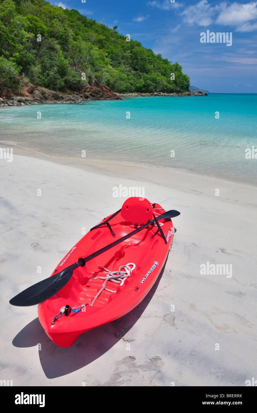 Red canoe at Megan's Bay. St. Thomas. US Virgin Islands. - Stock Image