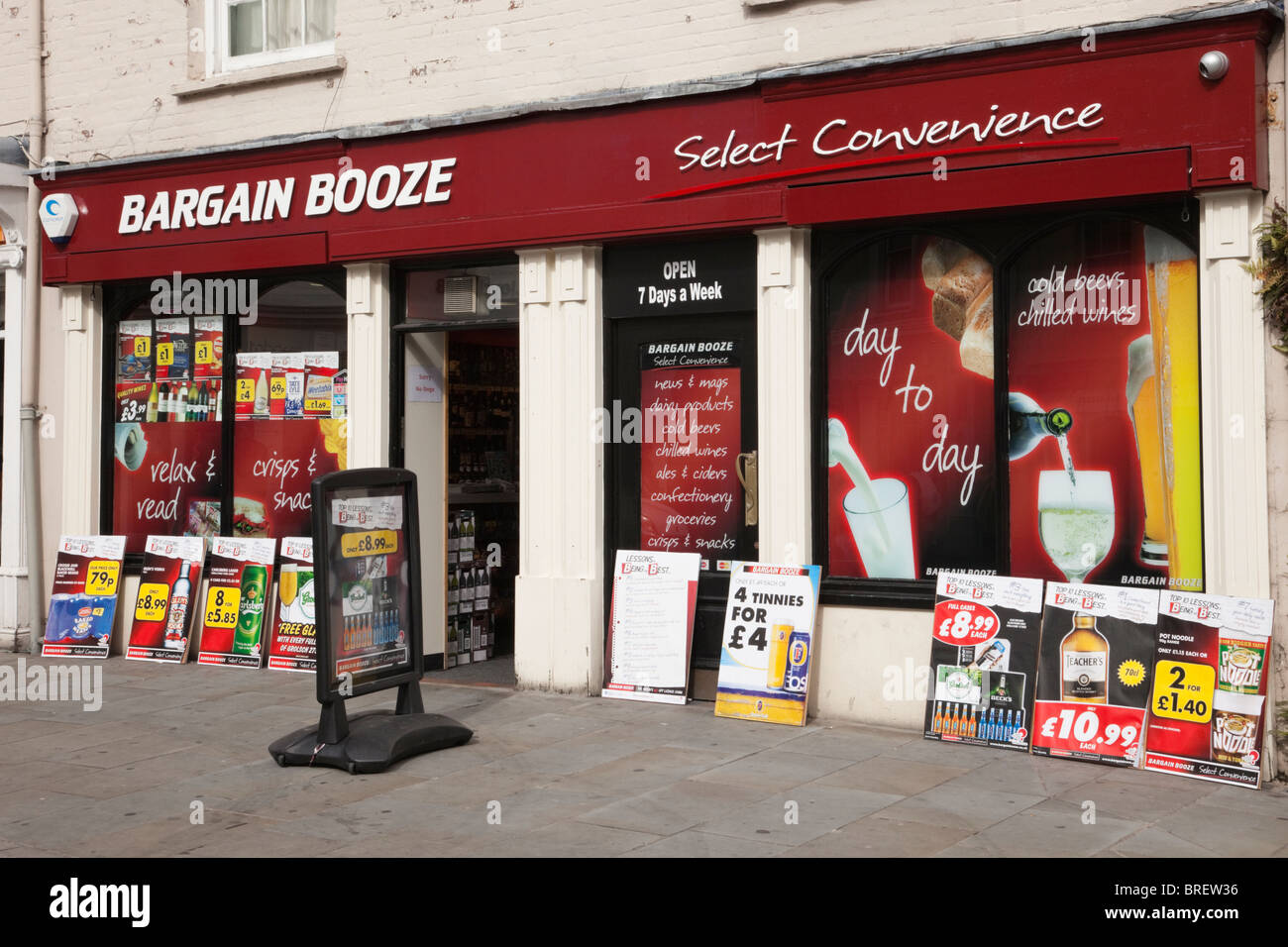 Bargain Booze shop front window with adverts for cheap alcohol. Wales, UK, Britain - Stock Image