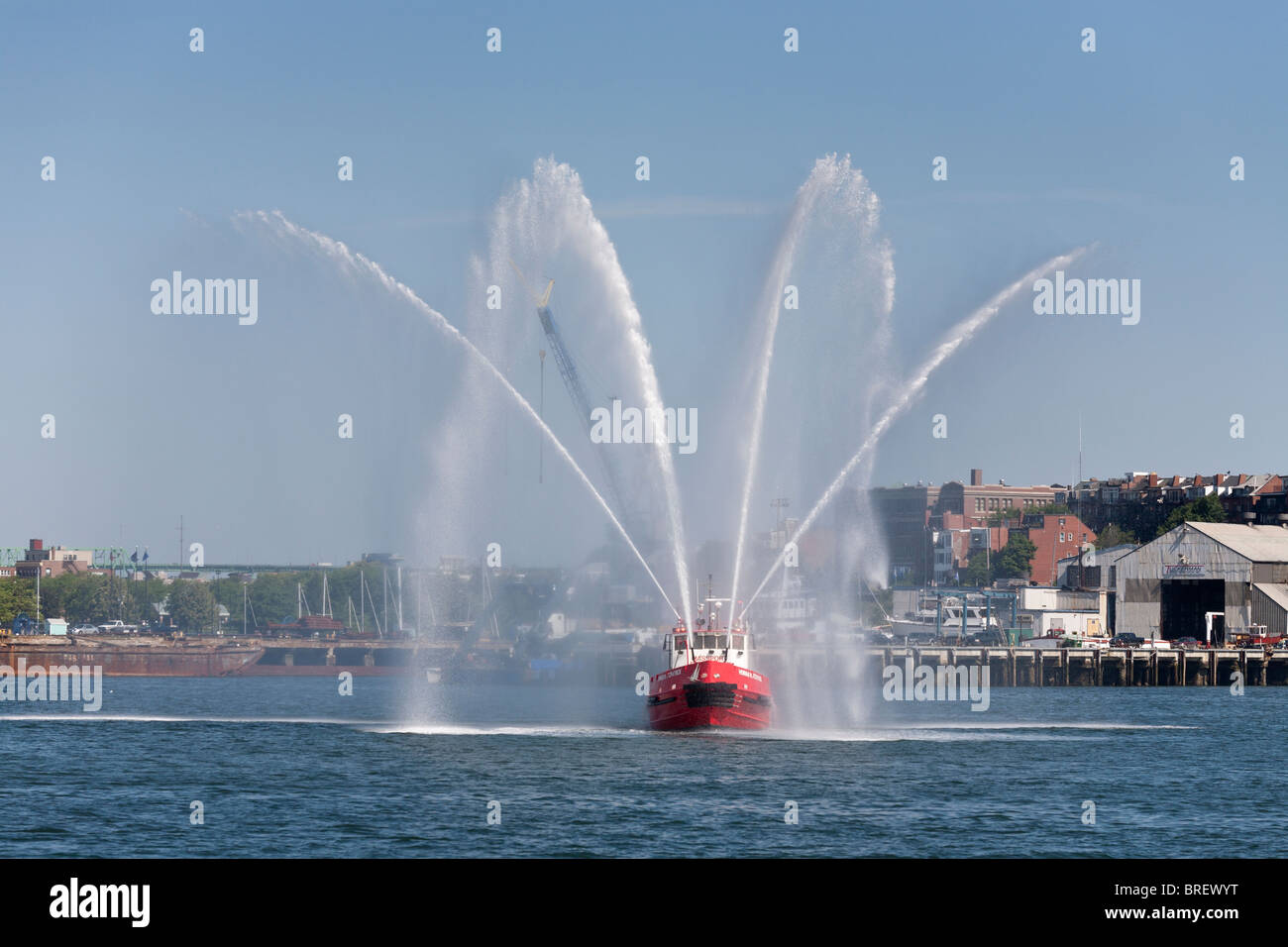 Massport fire boat #1 water display. The Howard W. Fitzpatrick a fire fighting tug boat puts on a watery display - Stock Image
