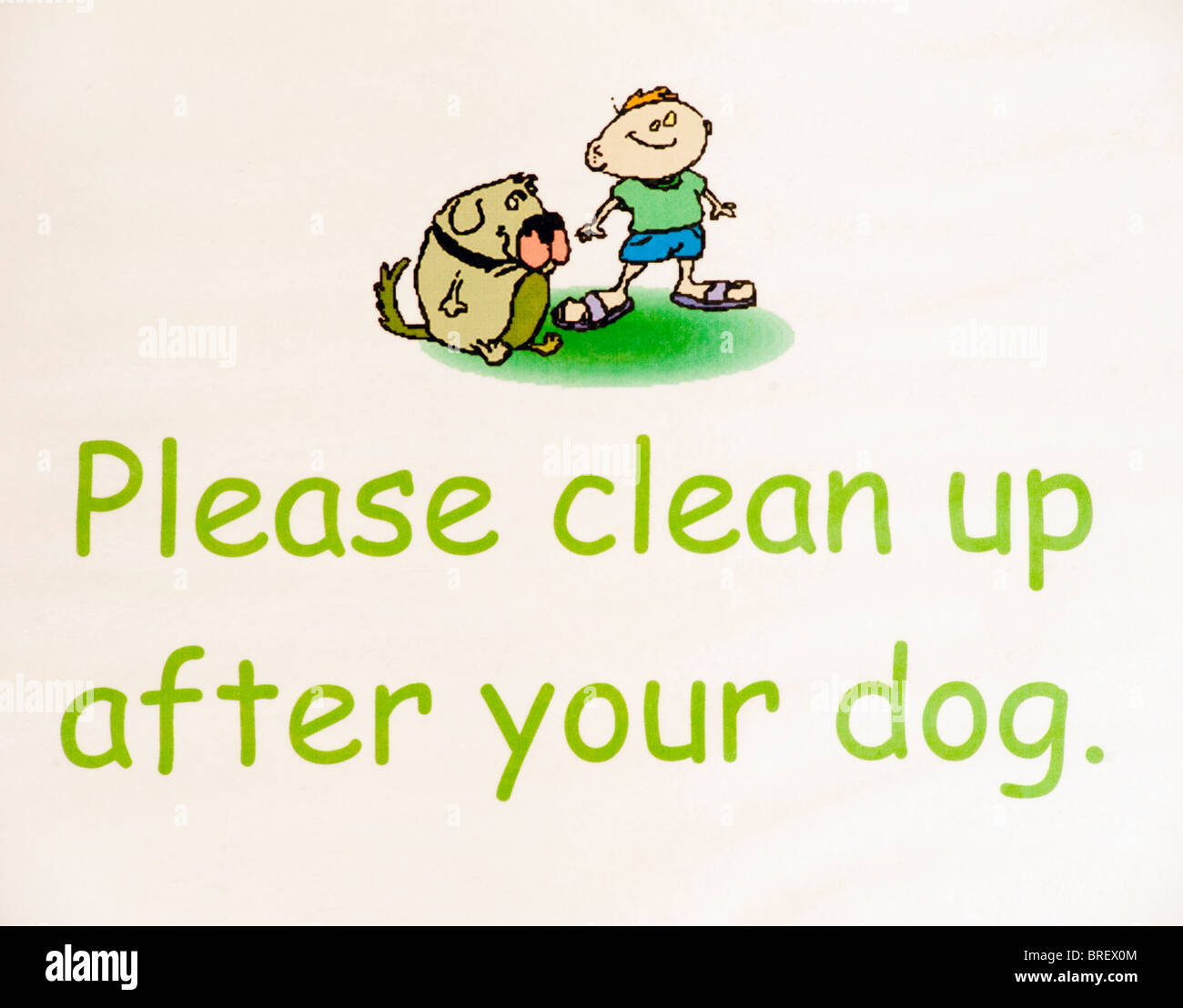 Notice displaying Please clean up after your dog - Stock Image