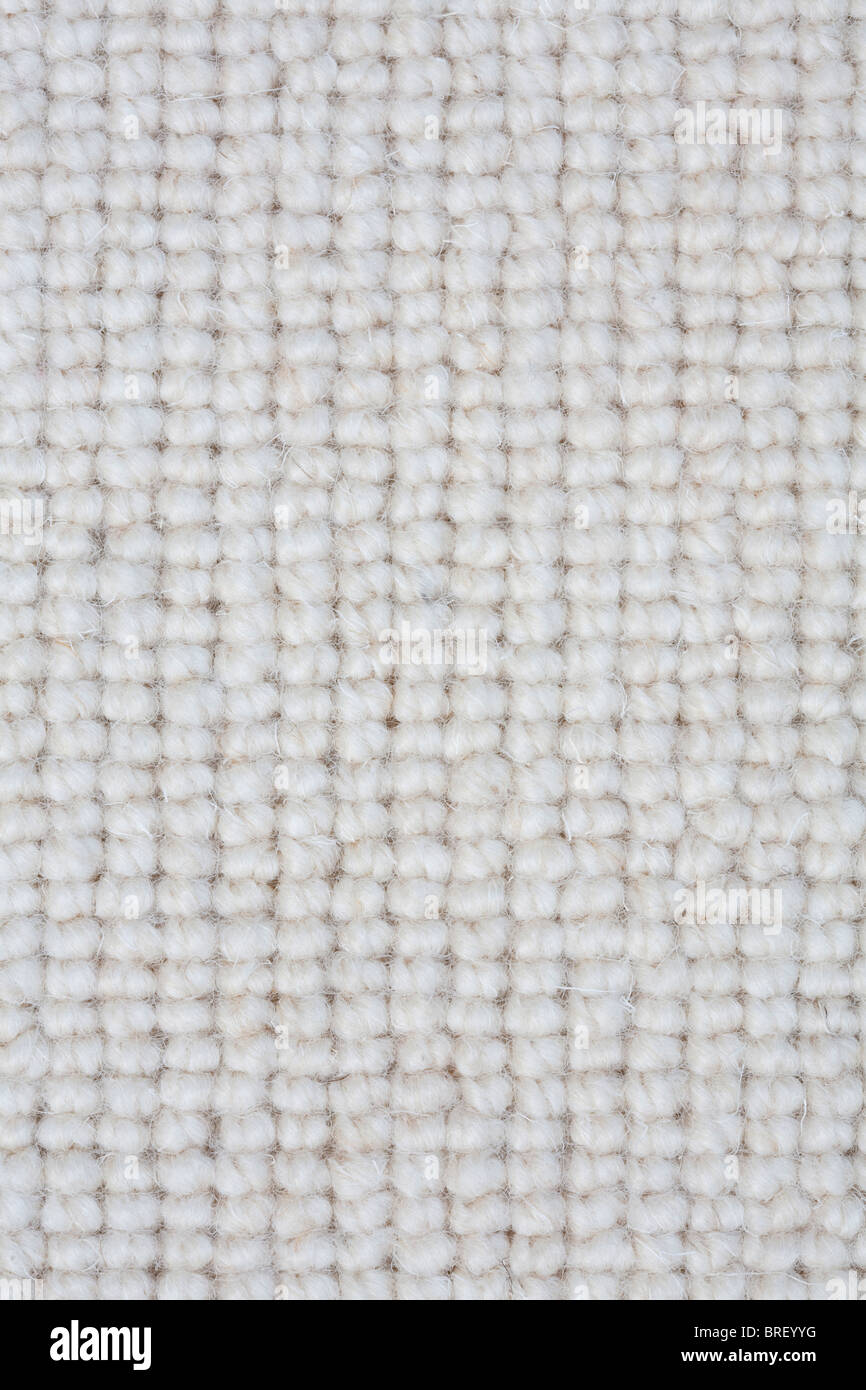Detail of a light colored carpet ideal for a textured background - Stock Image