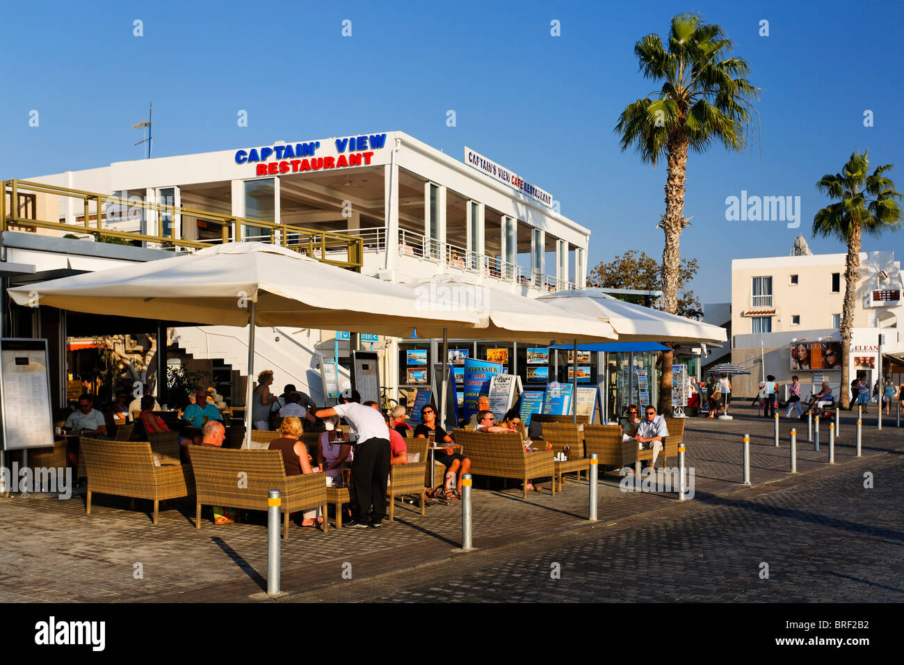 Shore promenade with people, shops, restaurants and palm trees, Kato, Paphos, Pafos, Cyprus, Europe Stock Photo