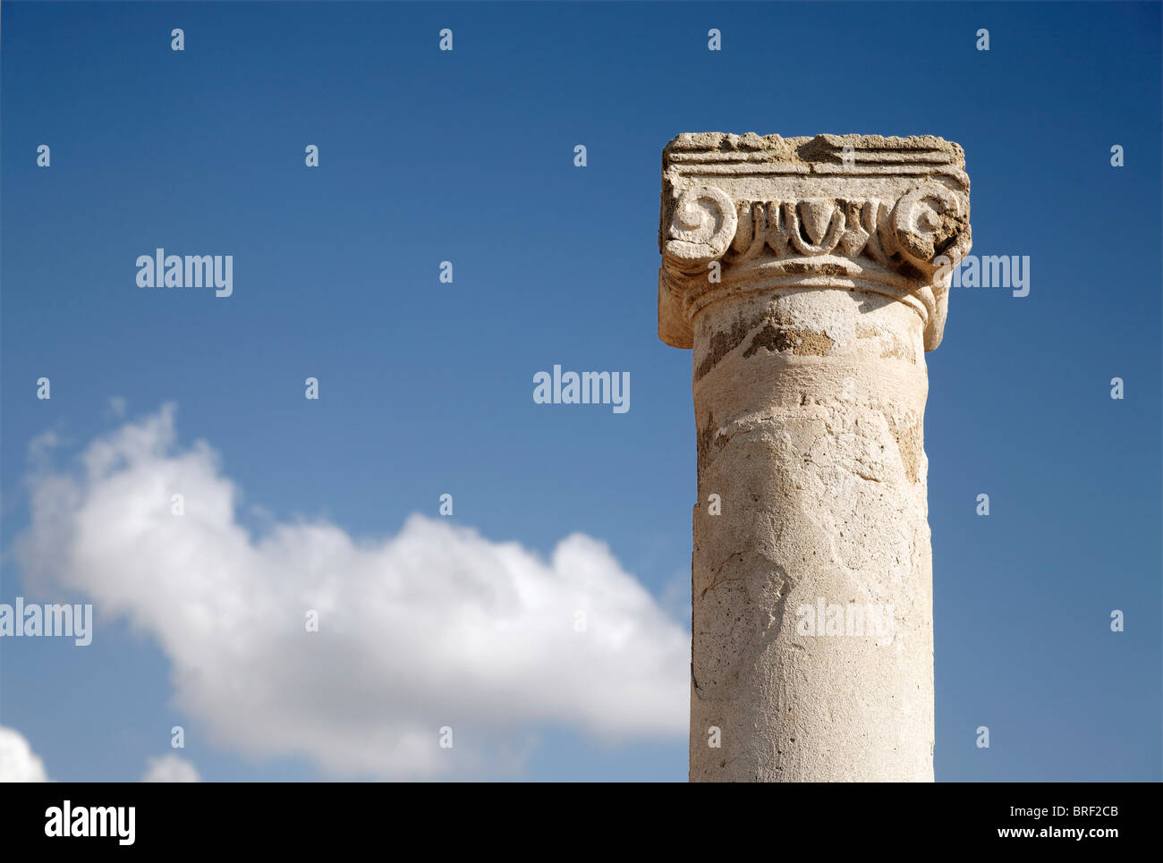Ancient Greek column, capital, abacus, blue sky, white clouds, UNESCO World Heritage Site, Kato, Paphos, Pafos, - Stock Image