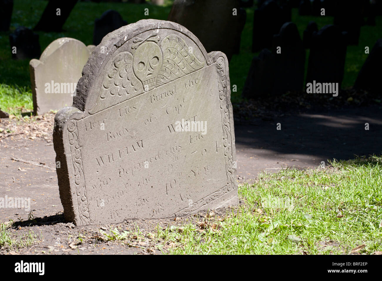 Old Tombstone for William Watt sinking. Skull with wings design of an old grave stone in the Old Granary Burying - Stock Image