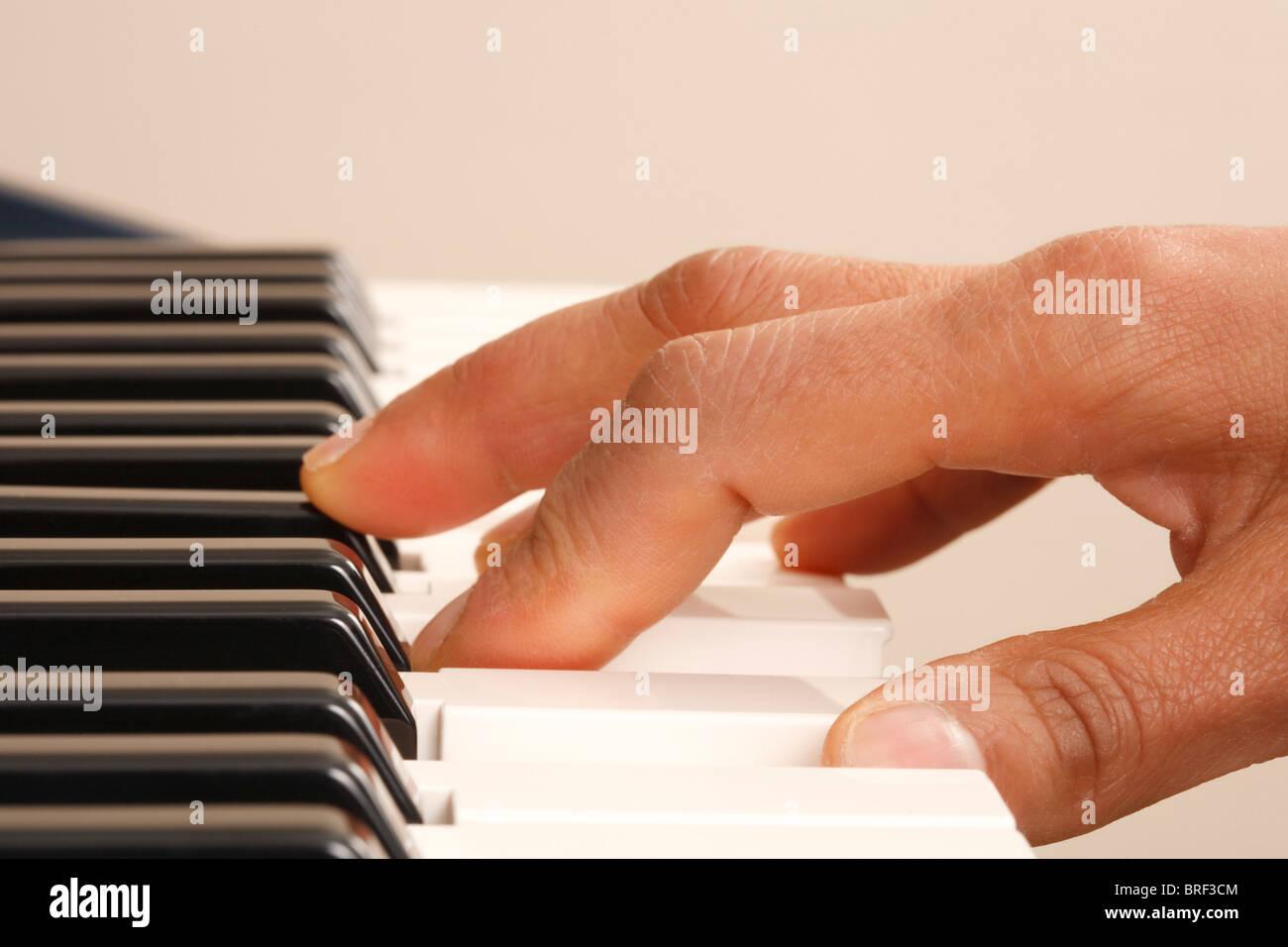 Closeup of a woman playing piano - Stock Image