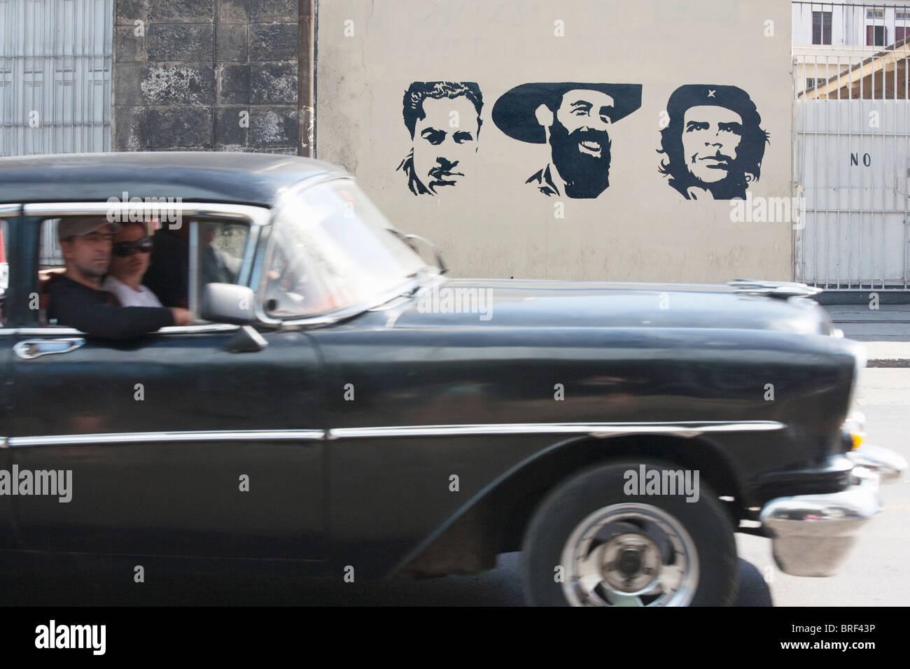 HAVANA: COMMUNIST GRAFFITI AND VINTAGE CAR Stock Photo