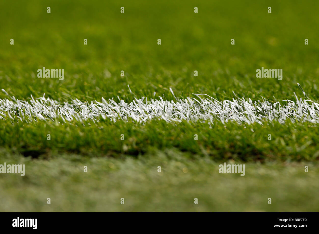 A white painted line on a Football pitch - Stock Image