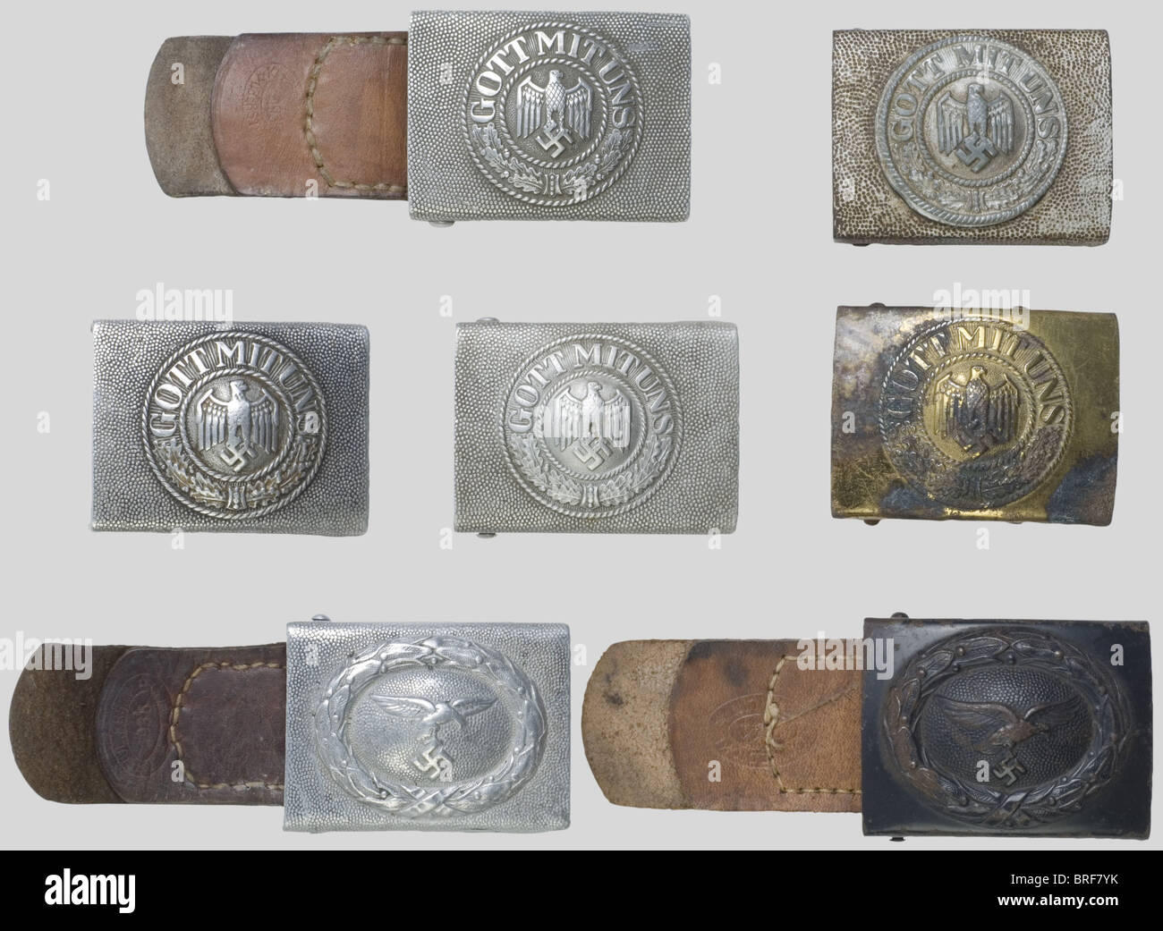 Seven belt buckles., Four for Army enclisted men, one of which with its leather belt dated 1937. One for Kriegsmarine - Stock Image