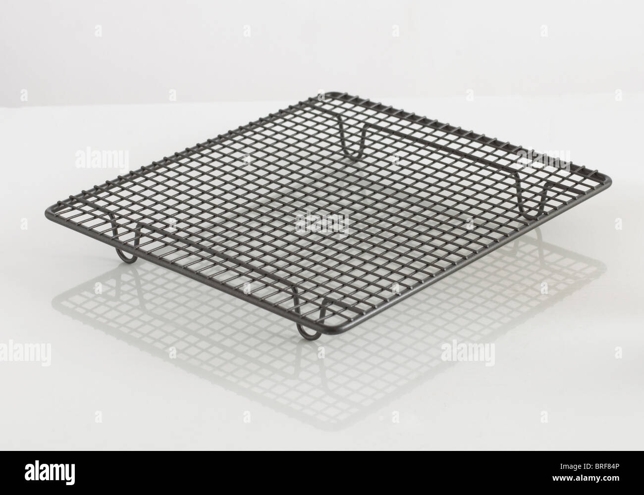 Wire cooling rack for baking on white background Stock Photo ...
