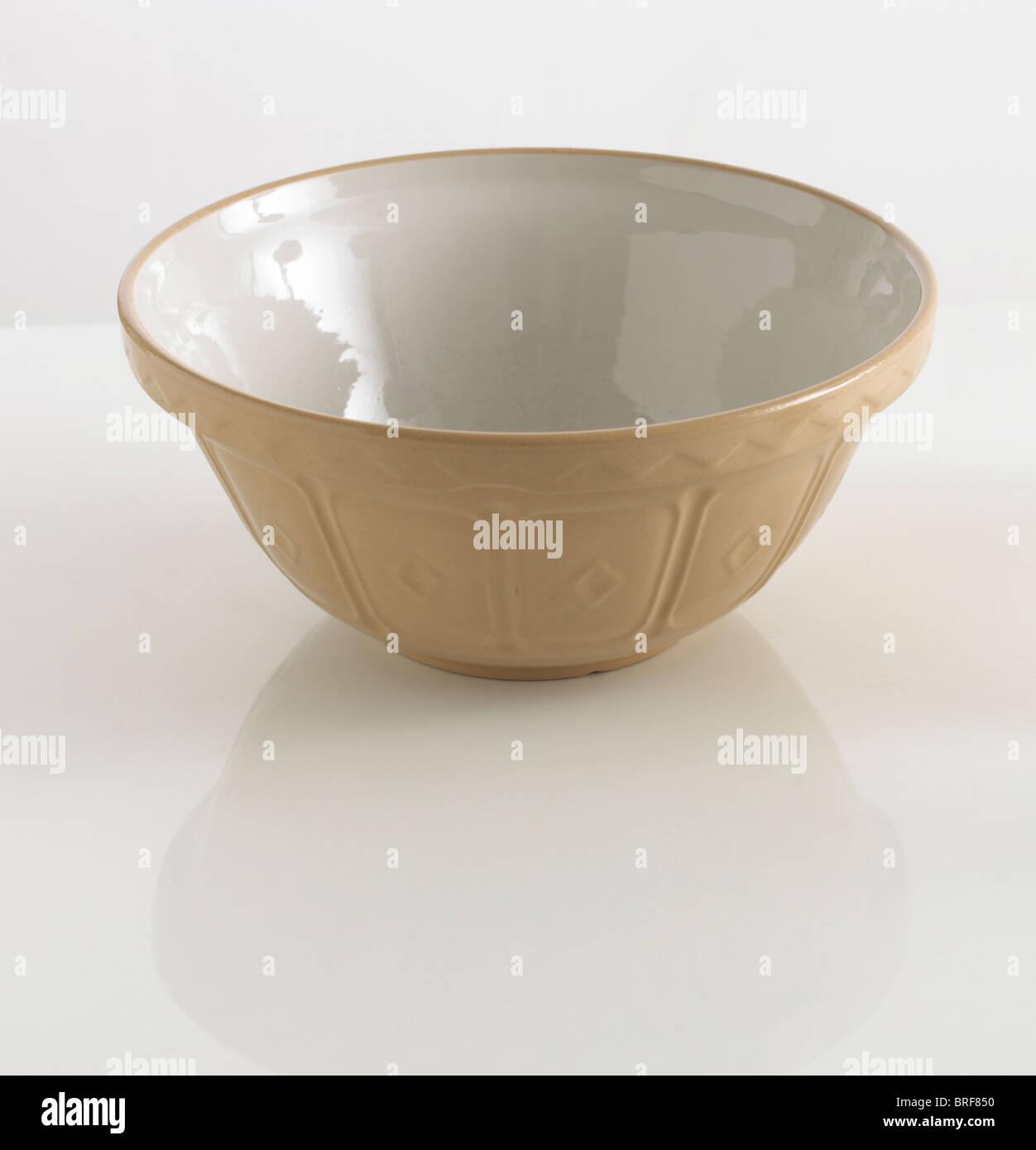 Large empty mixing bowl on white background - Stock Image