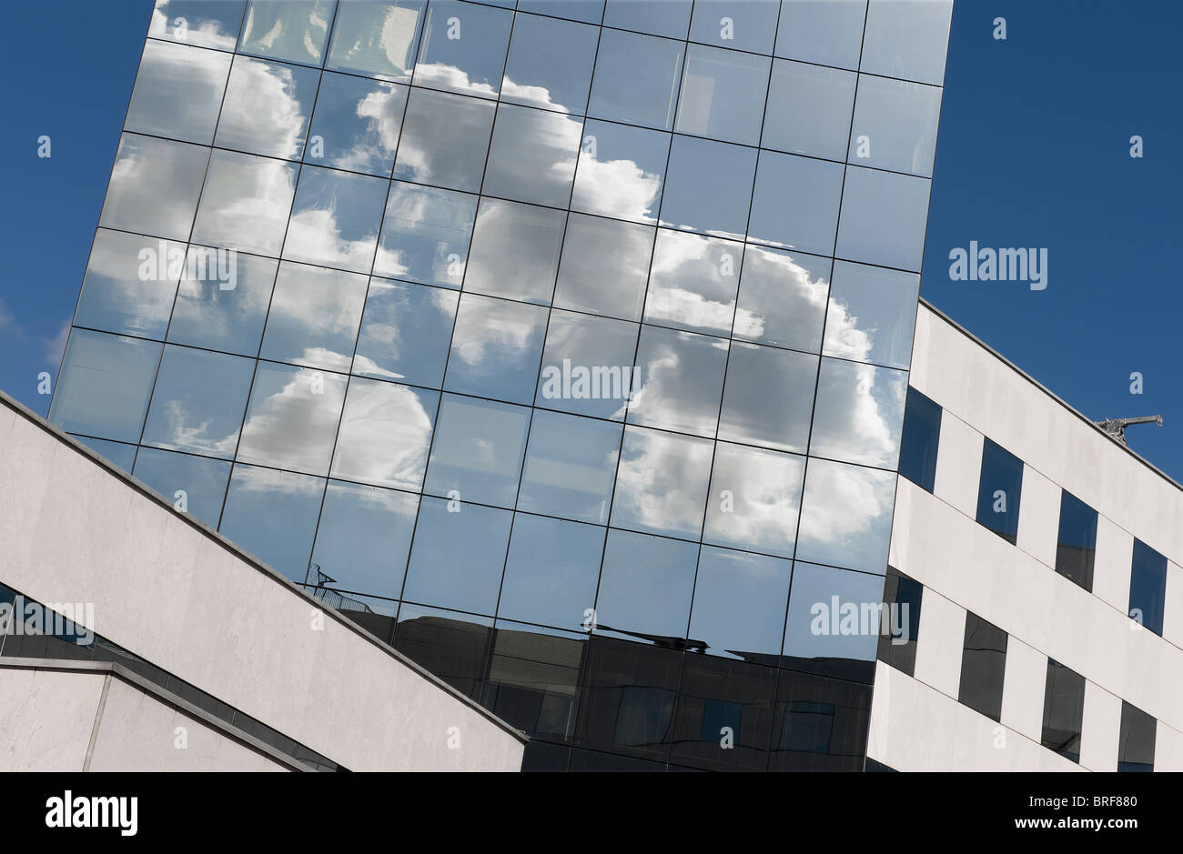 clouds reflected in modern glass building, lille, france Stock Photo