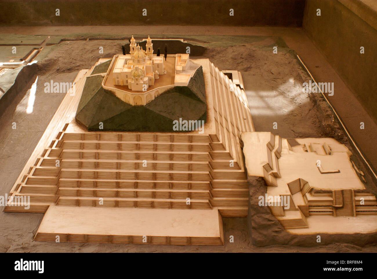 Model of Tepanapa Pyramid and Santuario de Nuestra Senora de los Remedios church in the archaeological site museum - Stock Image