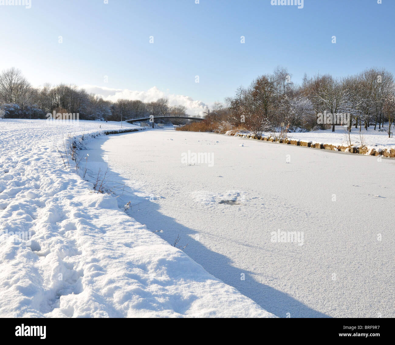 Frozen canal in the snow - Stock Image