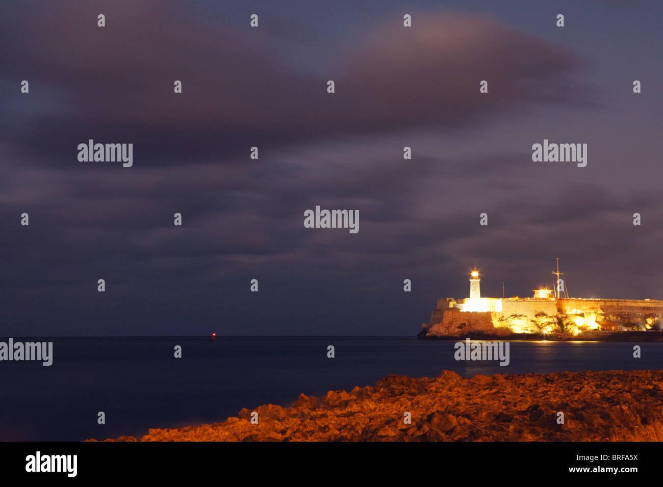HAVANA: MALECON AND CASTILLO DE LOS TRES REYES MAGOS DEL MORRO AND LIGHTHOUSE - Stock Image