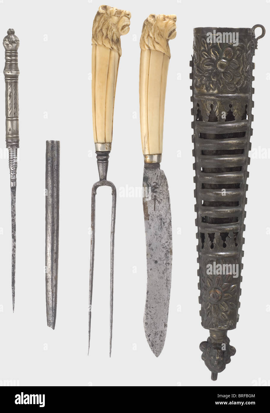 A set of German hunting cutlery, 18th century. Matching knife and fork with ivory handles, the pommel of each carved - Stock Image