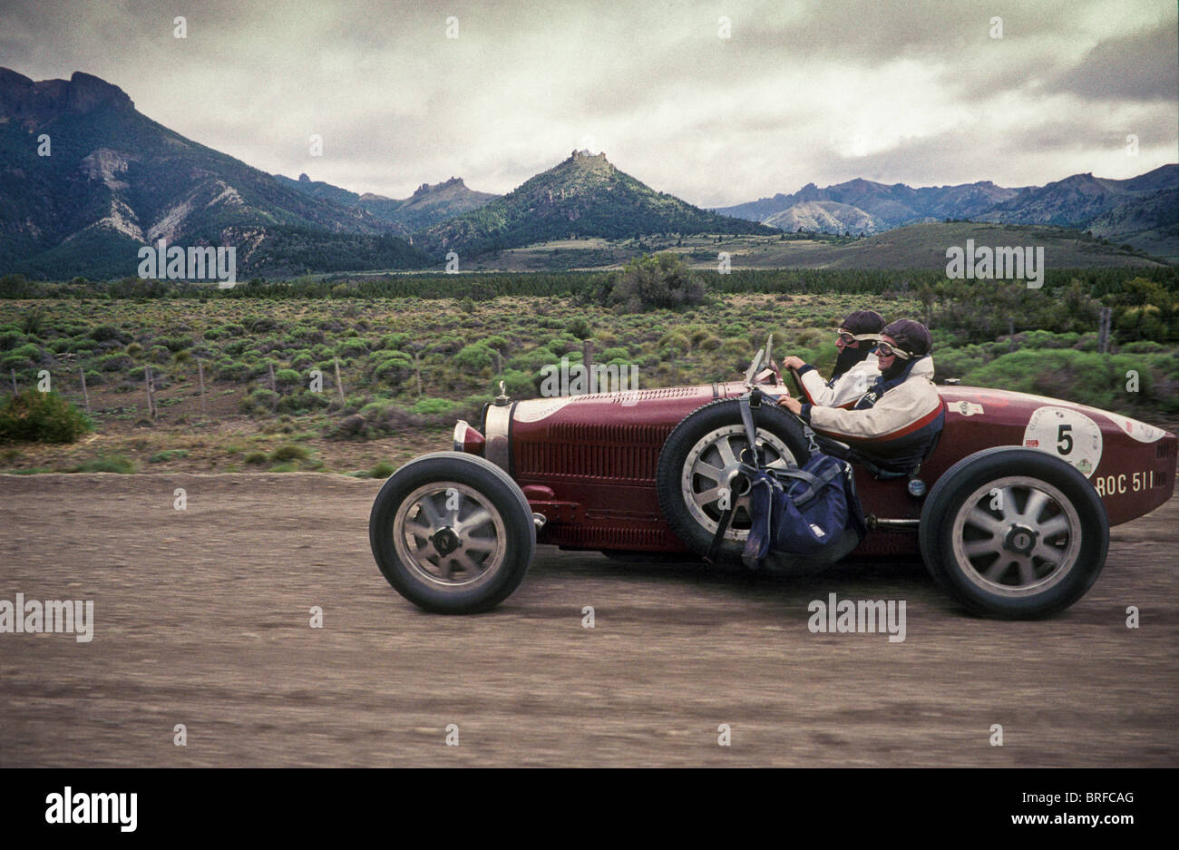 a classic Bugatti racing car takes part in the famous Mille Miglia (1000 mile) classic race in Patagonia, Argentina. - Stock Image