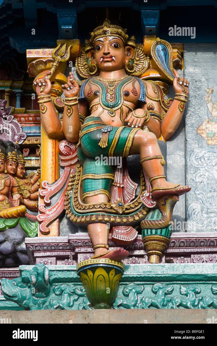 Stucco figures on Meenakshi Amman Temple's (Hindu;Saivite) east tower (gopuram); Madurai; Tamil Nadu; India - Stock Image