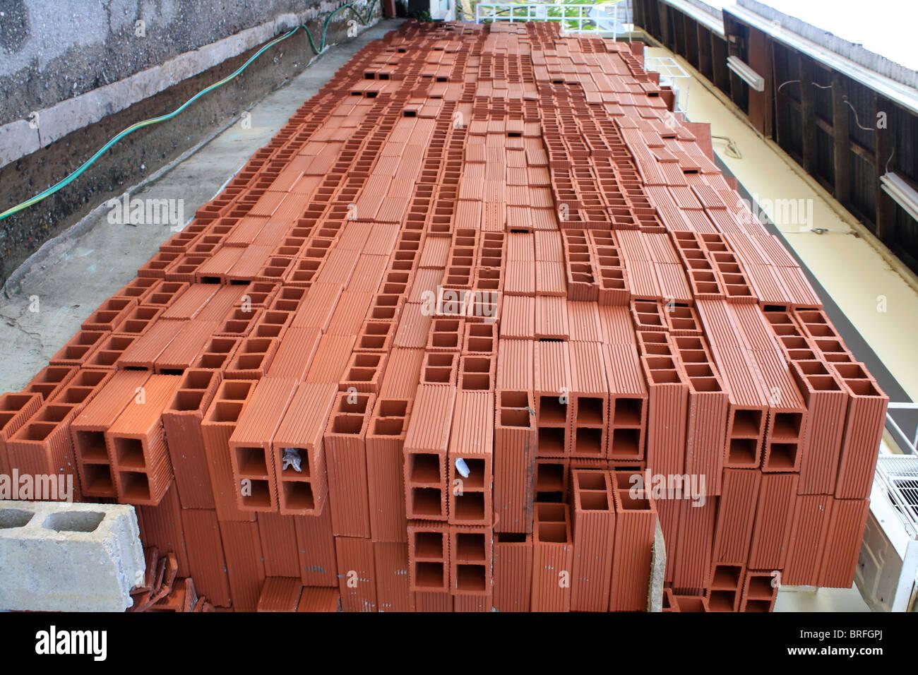 Row Red Bricks. - Stock Image