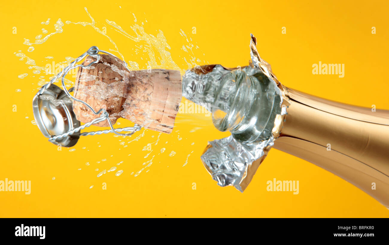 champagne bottle with shooting cork background - Stock Image