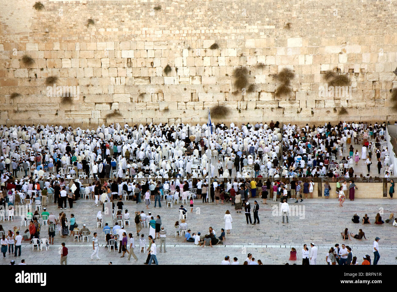 Jewish religious man with traditional clothes pray at the Wailing Wall in the old city of Jerusalem at Yom Kippur - Stock Image