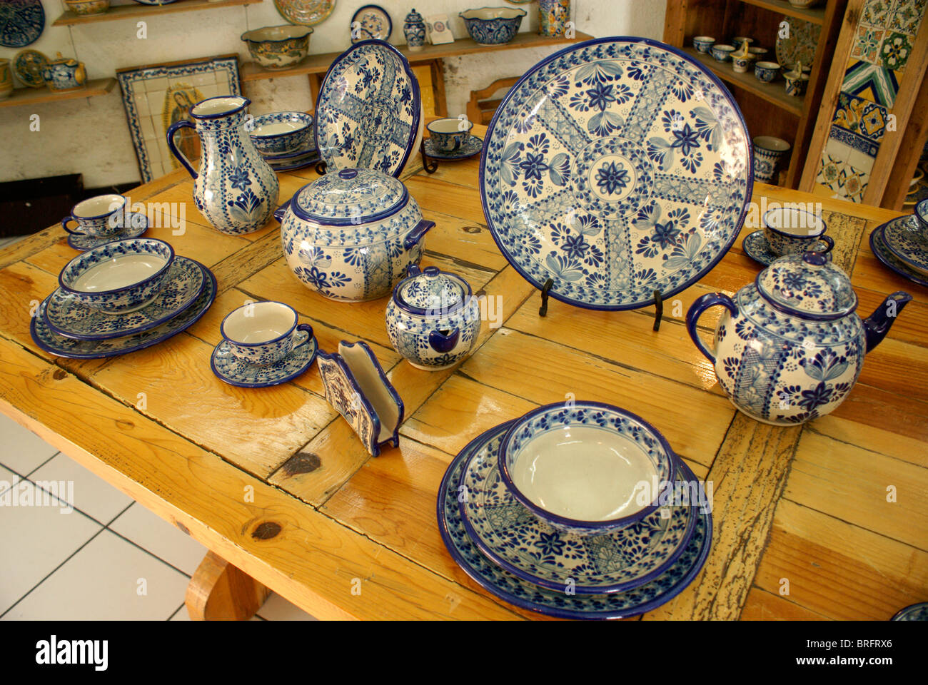 Genuine blue and white Mexican Talavera pottery for sale in Cholula, Puebla, Mexico. - Stock Image