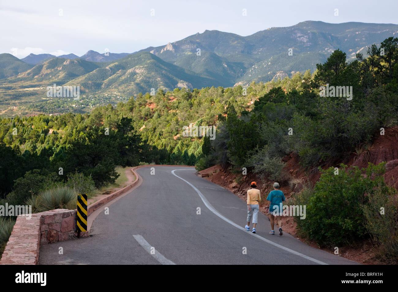 Visitors walking for exercise, Garden of the Gods, National Natural Landmark, Colorado Springs, Colorado, USA - Stock Image