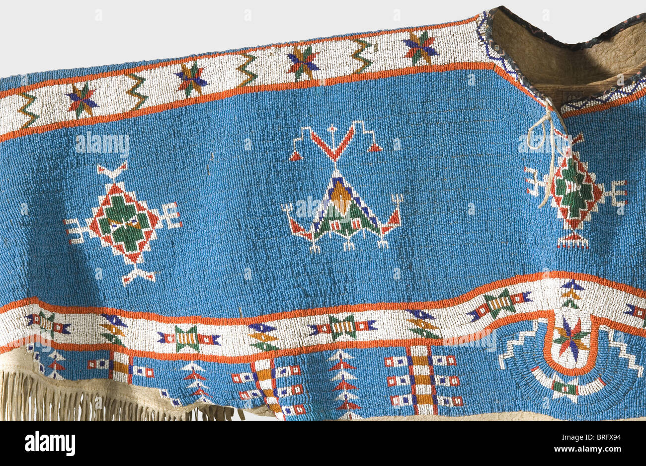 A Sioux woman's dress, circa 1900 A long leather dress with splendid bead work and hanging beaded leather thongs.Stock Photo