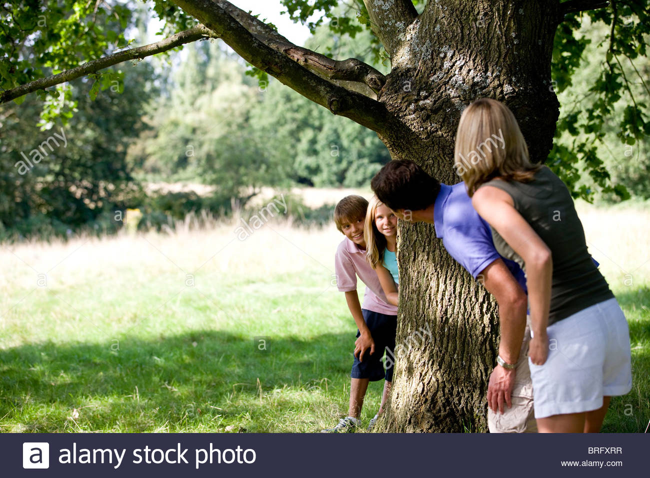 A family playing hide and seek - Stock Image