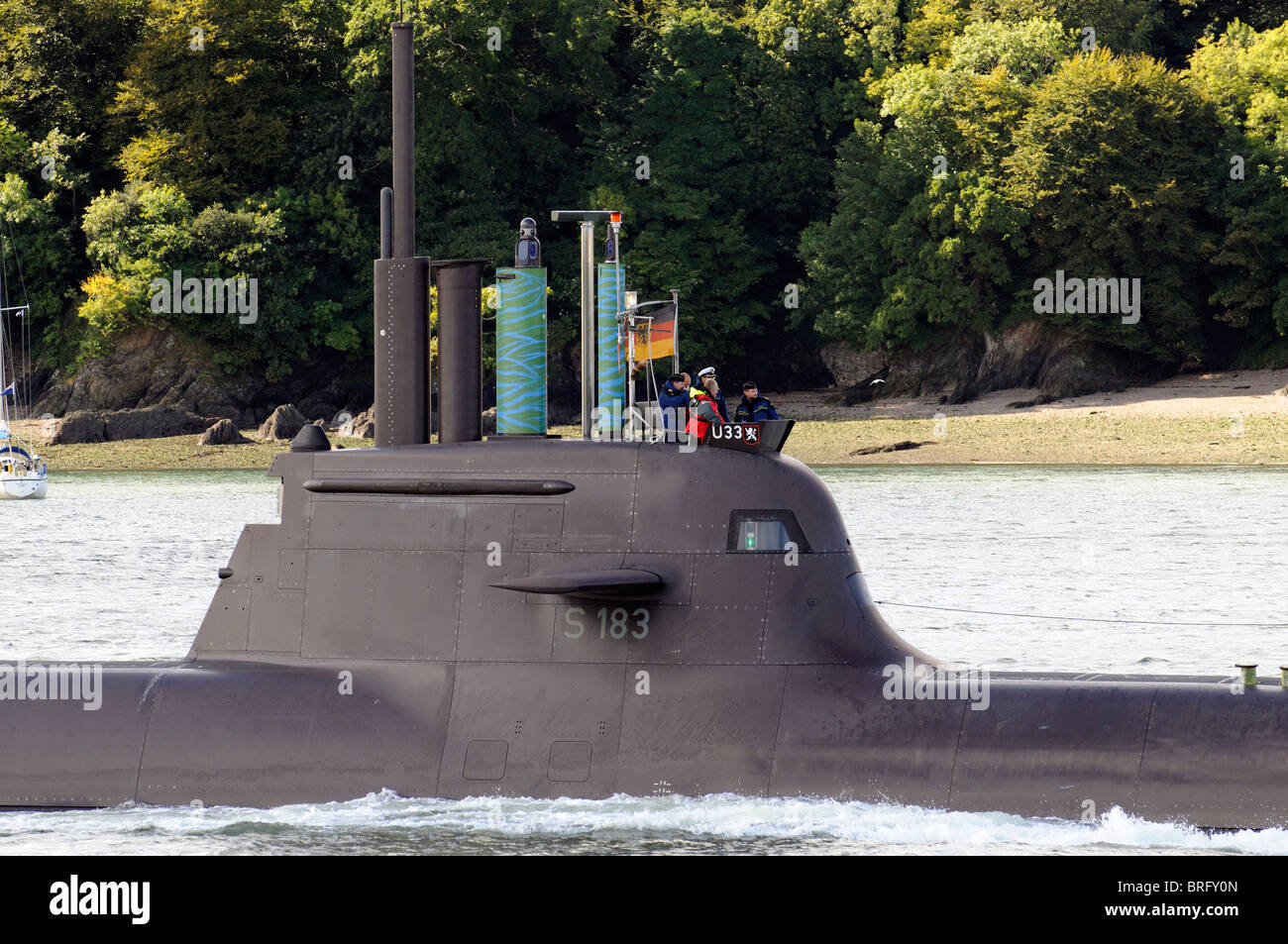 German Navy U33 submarine with officers on the conning tower of the vessel seen underway on the River Tamar Devon - Stock Image