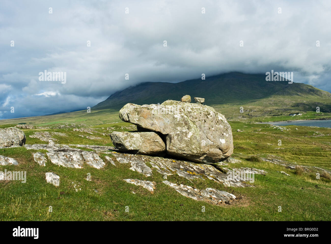 An anthropomorphic boulder at the foot of cloud shrouded Mweelrea mountain, county Mayo, Ireland - Stock Image