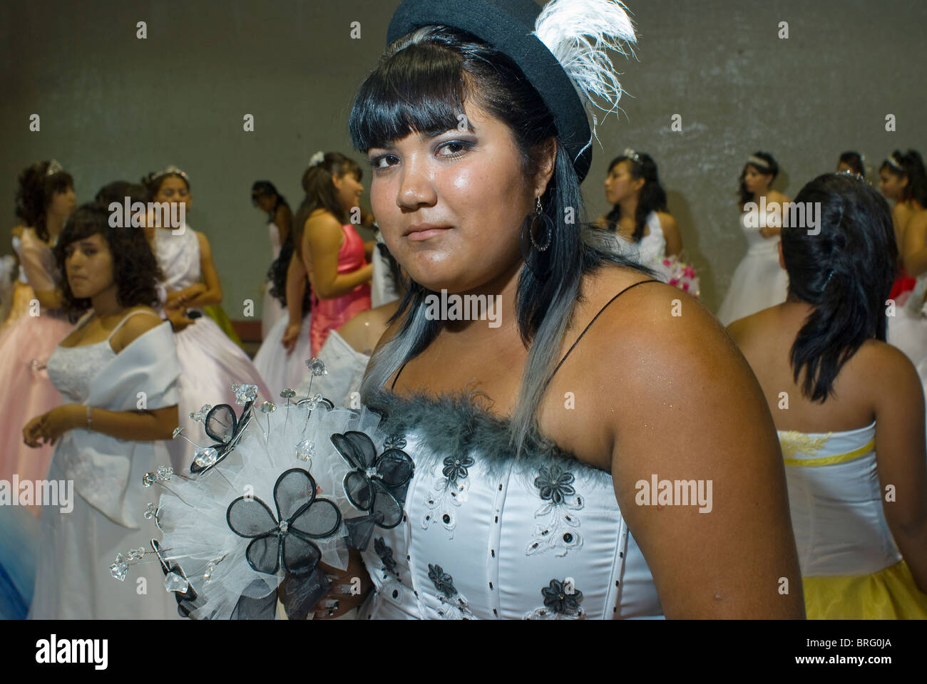 A quiceañera is a rite-of-passage ritual for many 15 year-old girls like this one in Latin American countries. Stock Photo