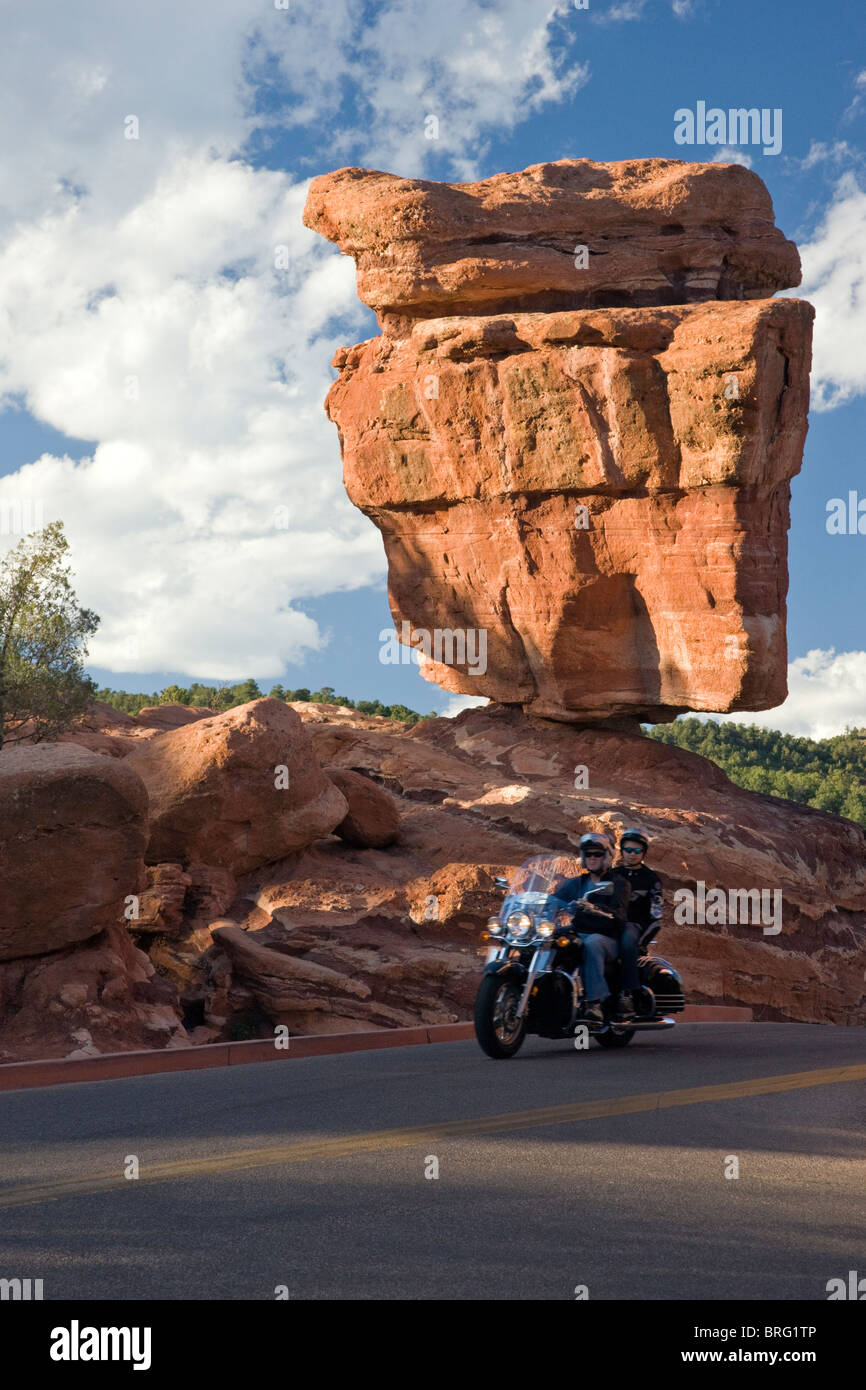 Couple on a motorcycle ride past Balanced Rock, Garden of the Gods, National Natural Landmark, Colorado Springs, - Stock Image
