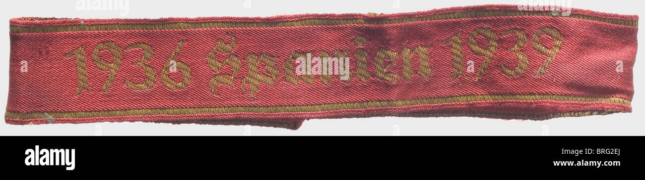 A '1936 Spanien 1939' sleeve band., Red cloth with gold machine-woven lettering. Length 38.5 cm. In beautiful - Stock Image