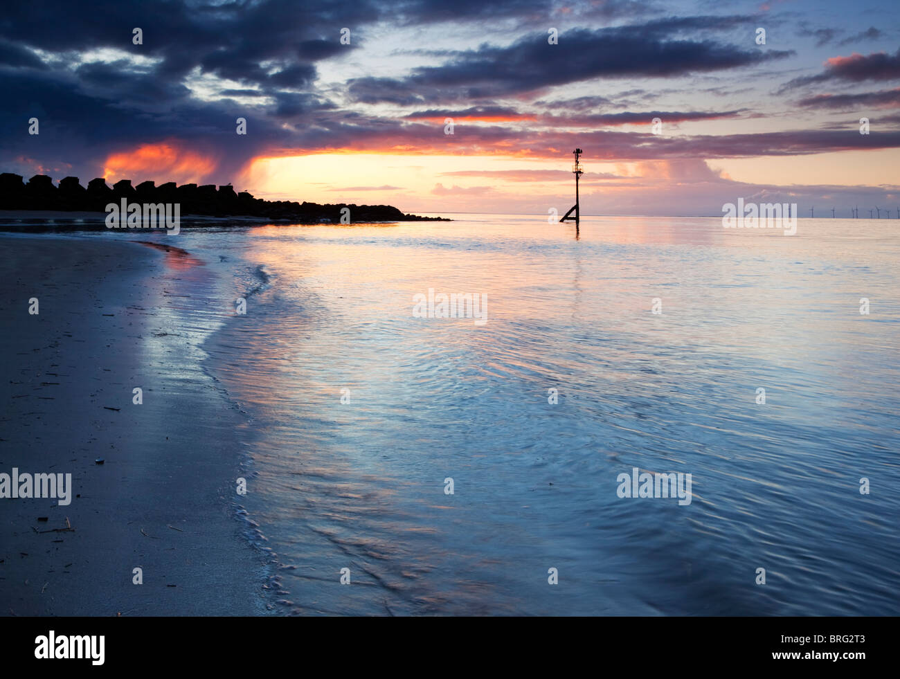 Low Tide Sunset, New Brighton Beach, Wirral Peninsula - Stock Image