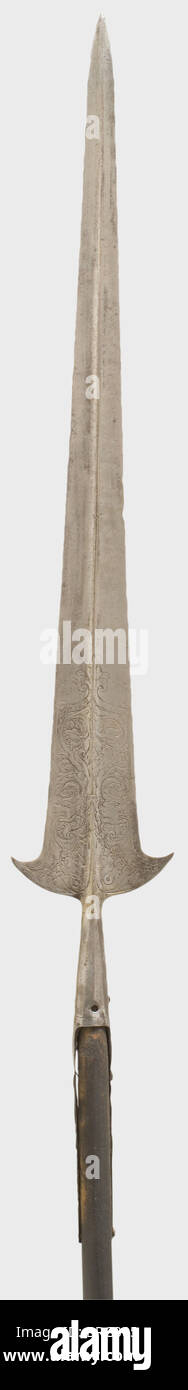 An etched Italian partisan, 16th century. Long double-edged blade with a central ridge on both sides. Parrying hooks - Stock Image