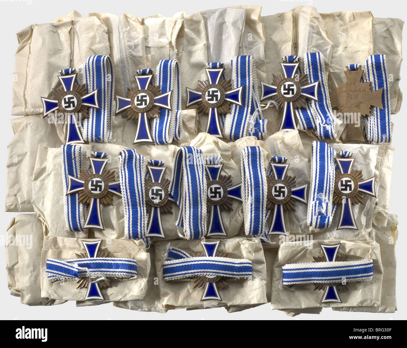 50 Mother's Crosses in Bronze, of the firm Deschler & Son. All are with ribbons, in original tissue papers, - Stock Image