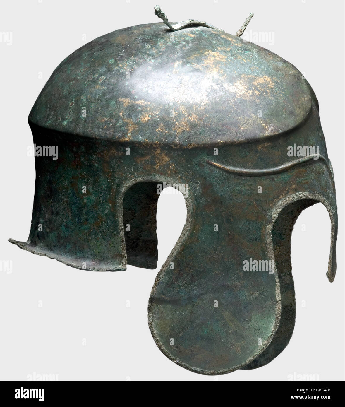 A Chalcidian helmet, 5th century B.C. Bronze. Narrow elongated skull with a carinated and crested crown, a fork - Stock Image